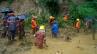 Bangladeshi fire fighters search for bodies after a landslide in Bandarban on 13 June 2017.