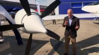 Theo Leggett next to an electric propellor