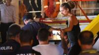 Carola Rackete, the 31-year-old Sea-Watch 3 captain, is escorted off the ship by police