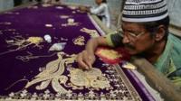 Man weaving a sari