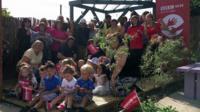 Volunteers and locals in the new community garden