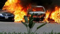 Cars are seen on fire at the scene of explosions and gunshots in Nairobi, Kenya January 15, 2019