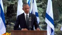 US President Barack Obama stands at the podium during Shimon Peres' funeral at Mount Herzl, Israel's national cemetery