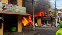 Building on fire after light aircraft crash in Bogota
