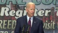 Joe Biden speaking on stage