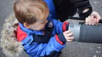 Young boy with air filter device