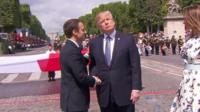 Presidents Macron and Trump shake hands