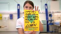 Student nurse holding poster