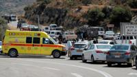 Israeli medics and security forces at scene of bomb attack near settlement of Dolev