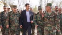 Bashar al-Assad and soldiers