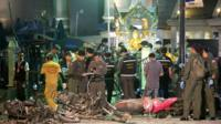 Police investigate the scene at the Erawan Shrine after an explosion in Bangkok