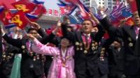 North Koreans at a procession