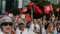 Demonstrators rally in support of police outside the Legislative Council in Hong Kong