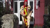 Marathon runner dressed as a hotdog