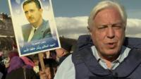 John Simpson surrounded by crowds in Syria