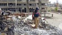 Mine clearance operative in rubble in Iraq