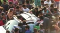 Migrants surrounding car