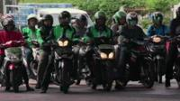 Motorcycle taxis in a row in Jakarta