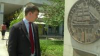 James Reynolds looking at a monument to the former Greek currency, the Drachma