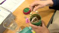 Woman putting coins into jar