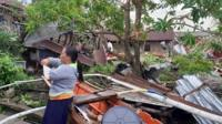 Residents survey damage from Typhoon Phanfone in Biliran, Philippines
