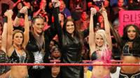 Stephanie McMahon, centre, in the WWE ring