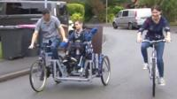 Lewis and family on their trike