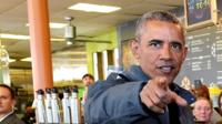 US President Barack Obama Obama buys cinnamon buns for Alaska cafe