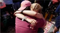 Newly-engaged couple hug at Glastonbury