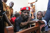 Bobi Wine in court holding a crutch