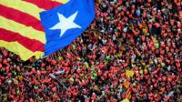 Aerial shot of protesters holding Catalonia's flag