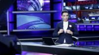 Rustavi 2 host on set