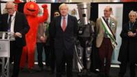 Boris Johnson next to a man in an Elmo suit