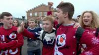 School children wearing Christmas jumpers