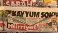 Newspaper headlines on display
