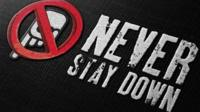 'Never Stay Down' logo
