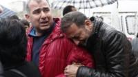 Grieving men in Ankara