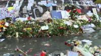 Flowers laid for victims of the Paris attacks
