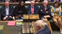 Boris Johnson and Jeremy Corbyn face each other
