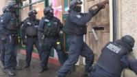 Police carry out drugs raid in Swansea