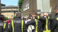 Firemen mark Grenfell silence
