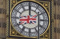 A British Union flag flutters in front of Big Ben