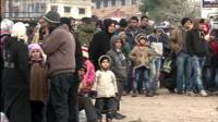Syrians wait for aid to arrive