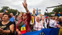 People protest in front of the government building in Chisinau, Moldova