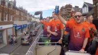Players on top of bus