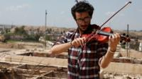 Violinist Ameen Mukdad plays in east Mosul