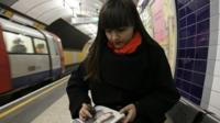 Liz Atkin drawing on tube platform