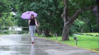 A woman walking on a footpath