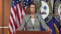 Nancy Pelosi at a podium
