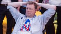 A supporter of the Stronger In campaign reacts after hearing results in the EU referendum